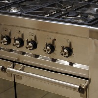 a stainless steel gas range and oven
